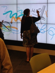 Our boss, Nadine, enjoying the giant Interactive Wall.
