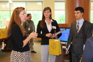 New M1 students receiving leased iPads during the 2014 orientation fair