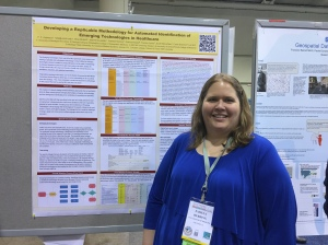 Pammy presenting her team's poster